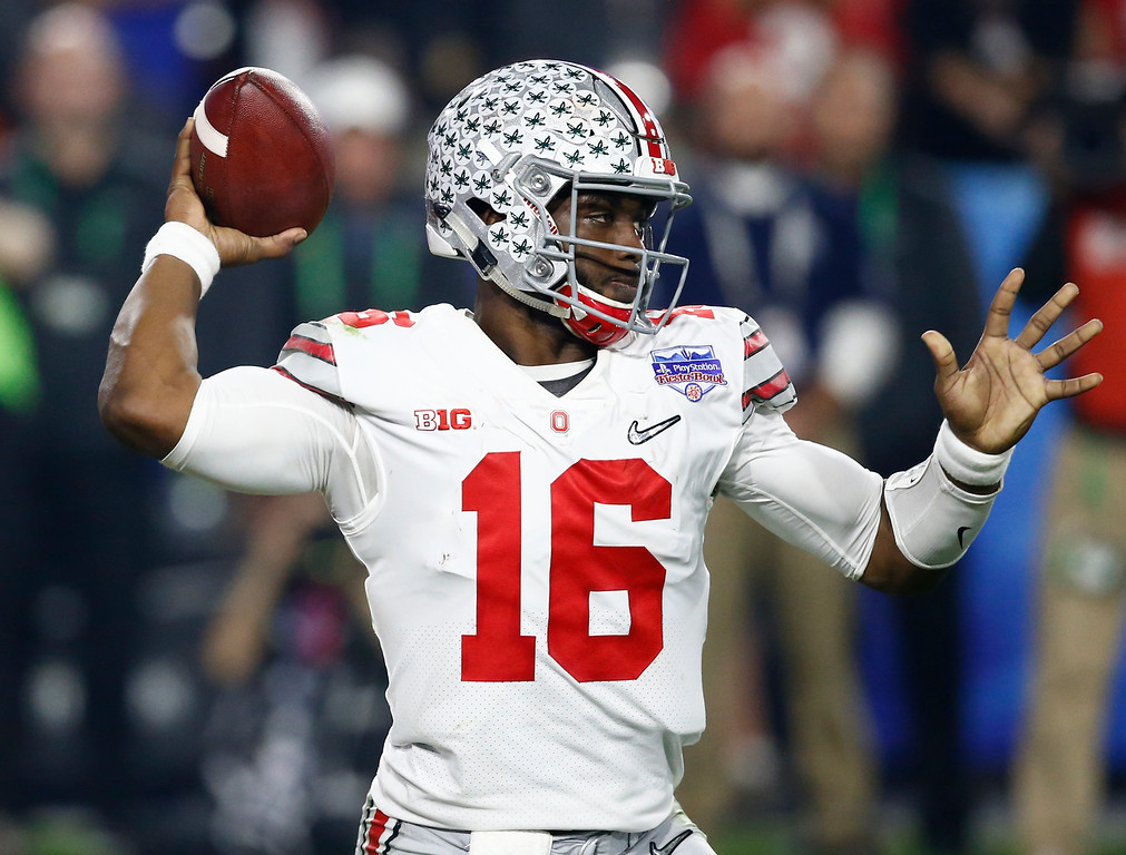 . Ohio State quarterback J.T. Barrett (16) looks to pass against Clemson during the first half of the Fiesta Bowl NCAA college football game, Saturday, Dec. 31, 2016, in Glendale, Ariz. (AP Photo/Ross D. Franklin)