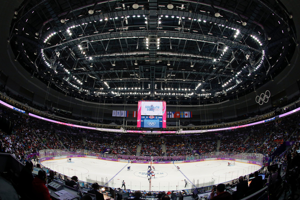 . Sweden and the Czech Republic face off to start the second period of a men\'s ice hockey game at the 2014 Winter Olympics, Wednesday, Feb. 12, 2014, in Sochi, Russia. (AP Photo/Julio Cortez)
