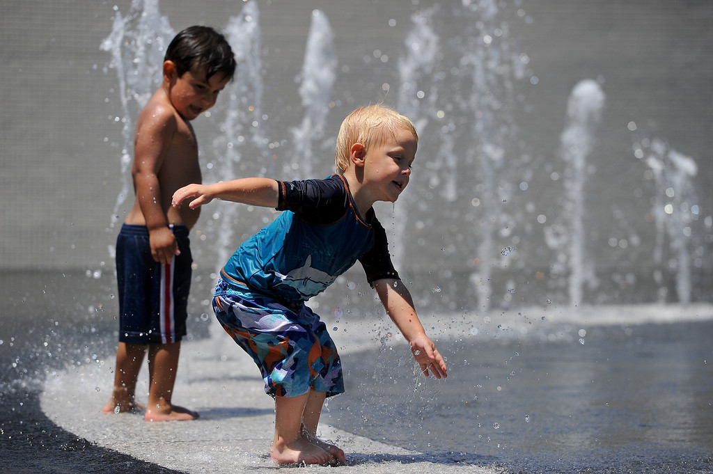 . Casimir Jacoby, 3, front, and Benni Preciado, 3, play in the fountain at Grand Park in downtown L.A.,Tuesday, May 13, 2014. (Photo by Michael Owen Baker/Los Angeles Daily News)