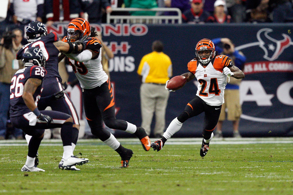 Description of . Adam Jones #24 of the Cincinnati Bengals returns a kick against the Houston Texans during their AFC Wild Card Playoff Game at Reliant Stadium on January 5, 2013 in Houston, Texas.  (Photo by Bob Levey/Getty Images)