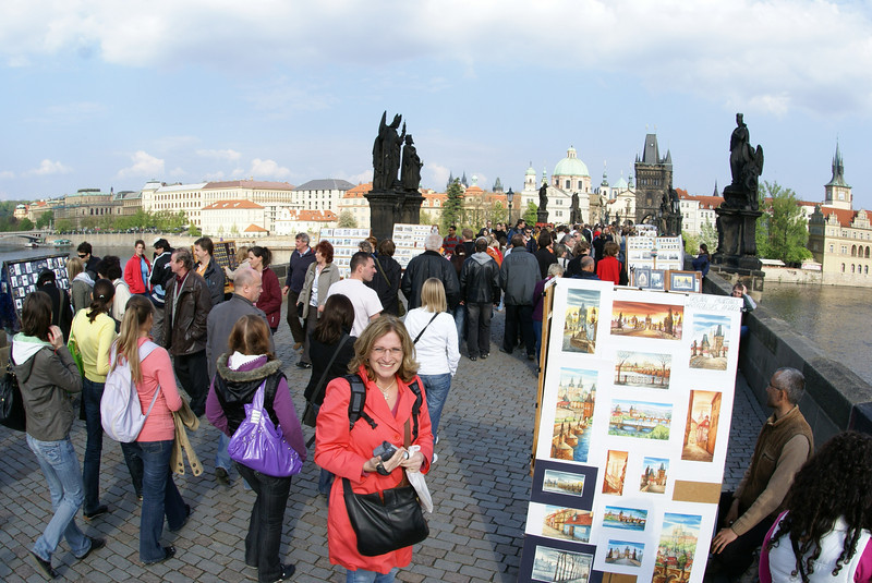 On the Charles Bridge there are no cars.  It's a chaotic place of vendors.  There's some pretty decent art - but there are way too many people.  The Attache probably didn't notice all the people.  She had buy buy buy on her mind.