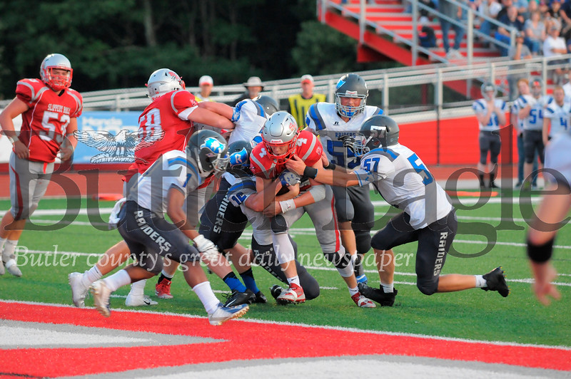 Slippery Rock #4 Vito Pilosi is tackled at the goal line by Reynolds #16 Cole Toy and #57 Hunter Jones during a game at Rocket Stdium on Friday August 31, 2018 (Jason Swanson photo)