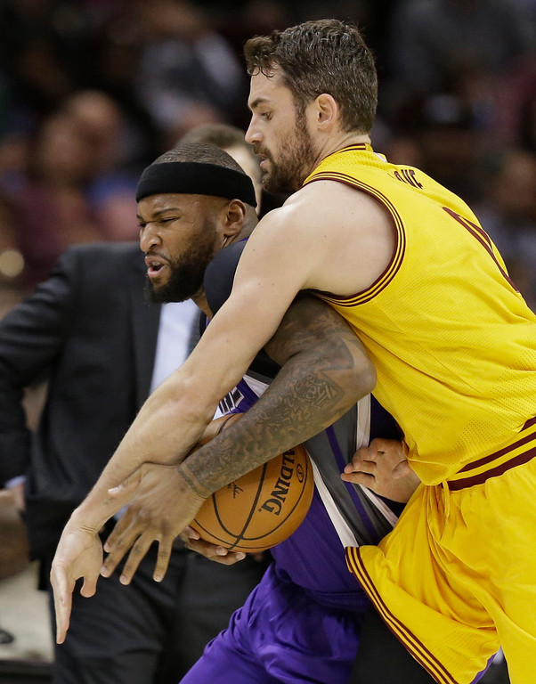 . Cleveland Cavaliers\' Kevin Love, right, fouls Sacramento Kings\' DeMarcus Cousins during the first half of an NBA basketball game, Wednesday, Jan. 25, 2017, in Cleveland. (AP Photo/Tony Dejak)