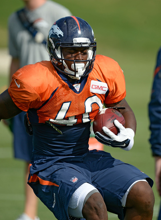 . Denver Broncos running back Juwan Thompson (40) runs through drills on day 12 of the Denver Broncos 2014 training camp August 5, 2014 at Dove Valley. (Photo by John Leyba/The Denver Post)
