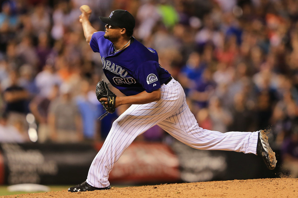 . DENVER, CO - JULY 26:  Relief pitcher Manny Corpas #60 of the Colorado Rockies delivers against the Milwaukee Brewers at Coors Field on July 26, 2013 in Denver, Colorado. The Rockies defeated the Brewers 8-3.  (Photo by Doug Pensinger/Getty Images)