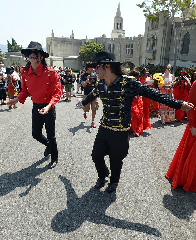 . (l-r) Rem Garza and Santana Jackson dance in front of the Mausoleum. Michael Jackson impersonators, and fans gathered at the Great Mausoleum at Forest Lawn Memorial Park in Glendale to honor Jackson on the 5th anniversary of his death.  Glendale, CA. 6/25/2014 (Photo by John McCoy Daily News)
