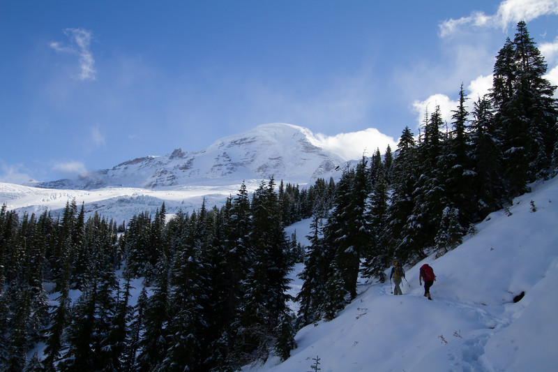 Mountain climbers approach Mount Baker on a snowy trail