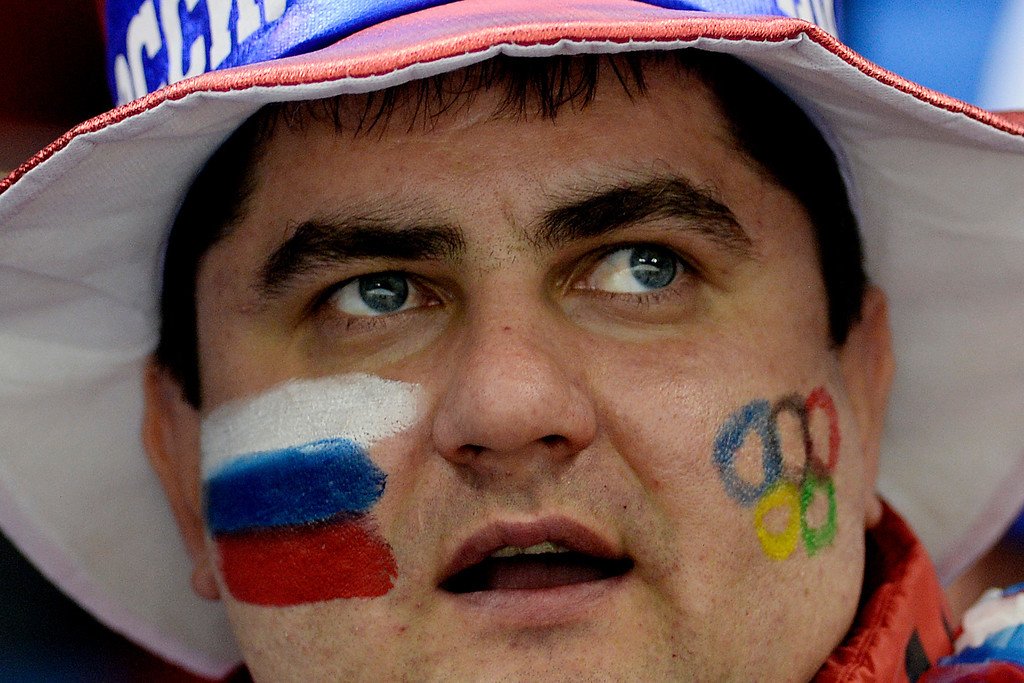 . A Russian fan watches the action between the U.S.A. and Switzerland during the second period of action at the Shayba Arena. Sochi 2014 Winter Olympics on Monday, February 10, 2014. (Photo by AAron Ontiveroz/The Denver Post)