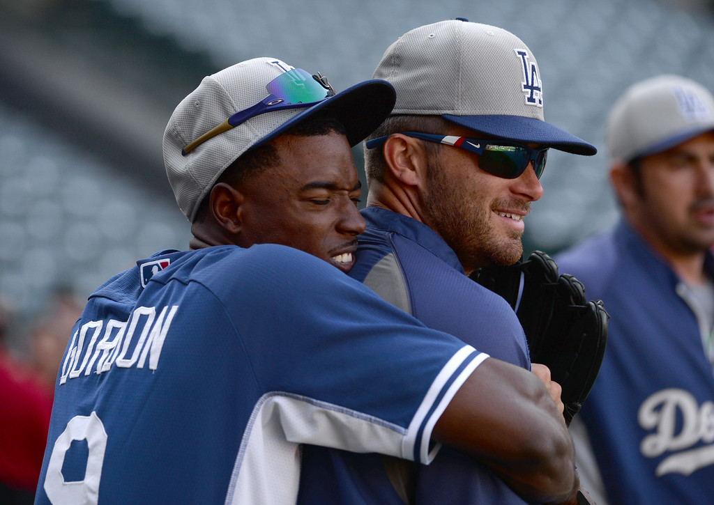 . Los Angeles Dodgers\' Dee Gordon has fun with a teammate prior to a baseball game against the Los Angeles Angels at Anaheim Stadium in Anaheim, Calif., on Thursday, Aug. 7, 2014.  (Photo by Keith Birmingham/ Pasadena Star-News)