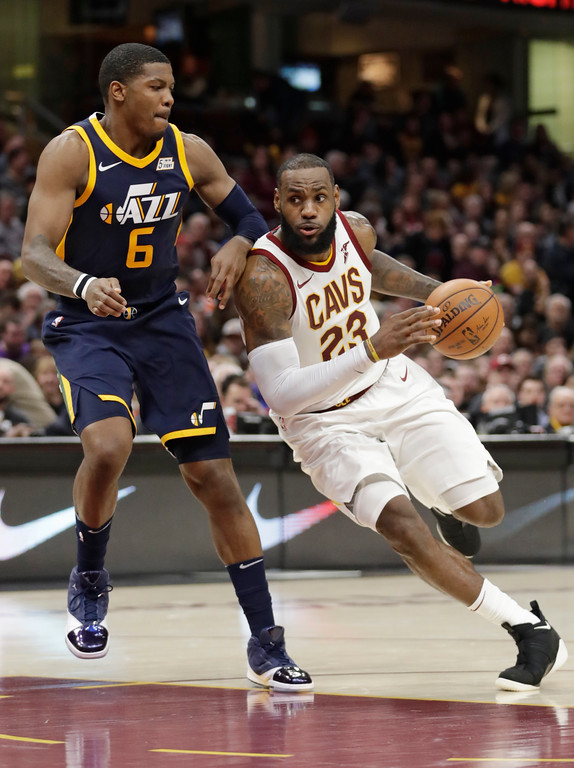 . Cleveland Cavaliers\' LeBron James (23) drives past Utah Jazz\'s Joe Johnson (6) in the second half of an NBA basketball game, Saturday, Dec. 16, 2017, in Cleveland. (AP Photo/Tony Dejak)