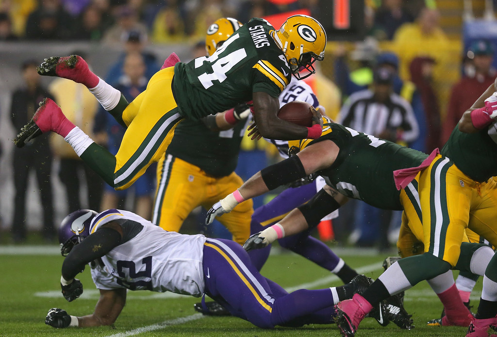. GREEN BAY, WI - OCTOBER 02:  James Starks #44 of the Green Bay Packers flys through the air on a 3 yard play against the Minnesota Vikings in the first quarter at Lambeau Field on October 2, 2014 in Green Bay, Wisconsin.  (Photo by Jonathan Daniel/Getty Images)