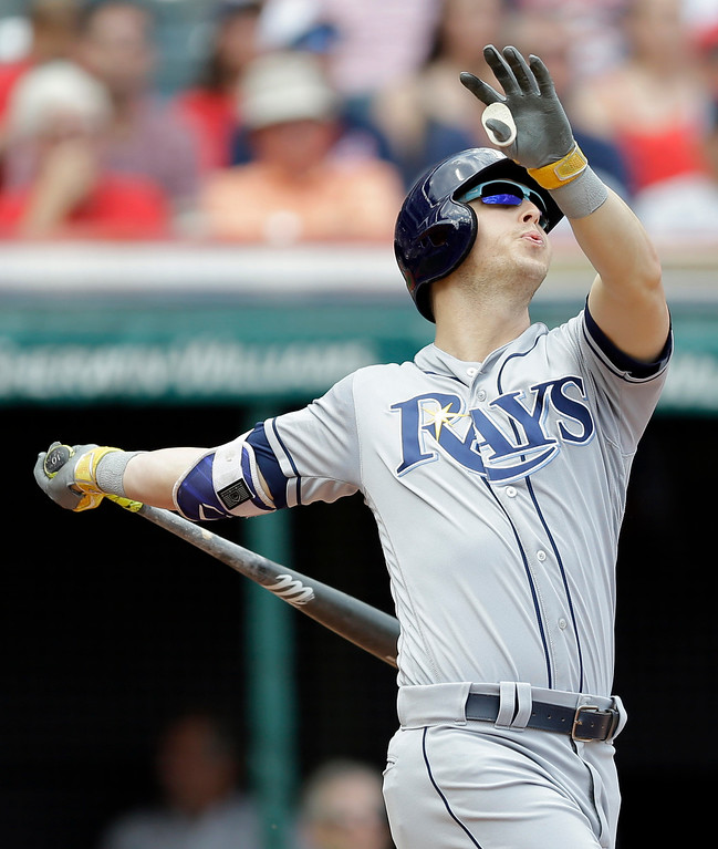 . Tampa Bay Rays\' Corey Dickerson hits a three-run home run off Cleveland Indians starting pitcher Josh Tomlin in the second inning of a baseball game, Wednesday, May 17, 2017, in Cleveland. Jesus Sucre and Daniel Robertson scored on the play. (AP Photo/Tony Dejak)