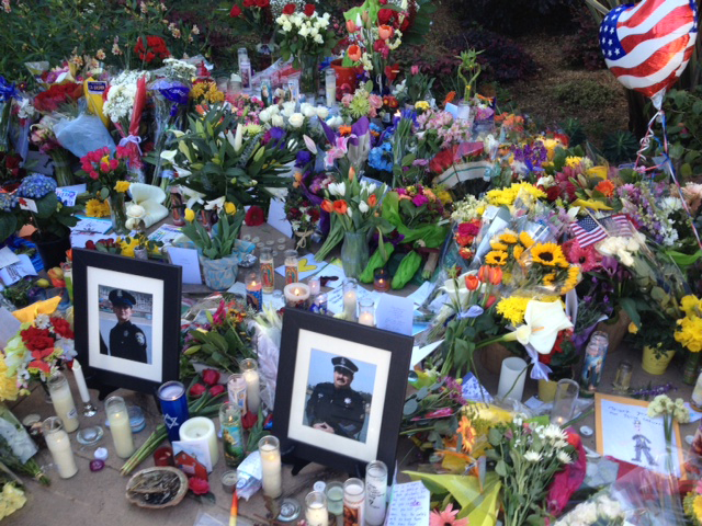 . The makeshift memorial outside the Santa Cruz Police Department has grown in the days following the shootings that took the lives of two officers, Loran Baker and Elizabeth Butler, in Santa Cruz, Calif. (Stephen Baxter/Sentinel)