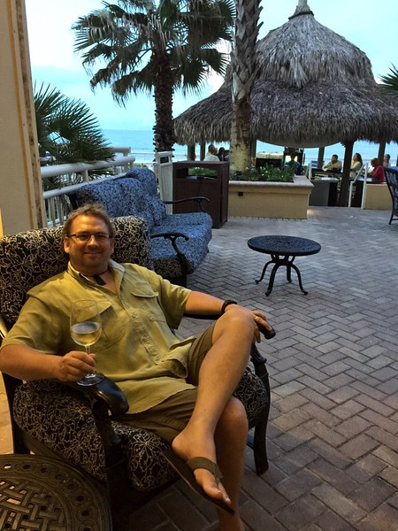 Dave enjoys a cocktail at sunset.JPG