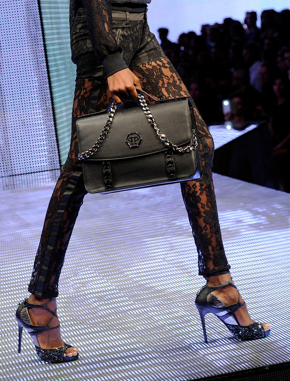 . A model wears a creation for Philipp Plein women\'s Spring-Summer 2014 collection, part of the Milan Fashion Week, unveiled in Milan, Italy, Saturday, Sept. 21, 2013. (AP Photo/Giuseppe Aresu)