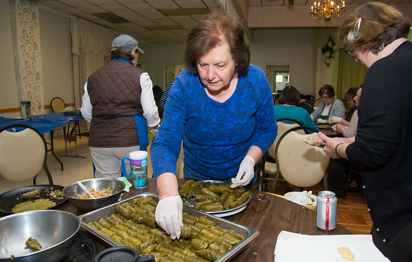 05/09/19 Wesley Bunnell | Staff Evanthina Tsakopoulos stacks freshly made stuffed grape leaves on Thursday afternoon for the upcoming Dionysis Festival at St. Georges Greek Orthodox Church on 5/17-5/19.