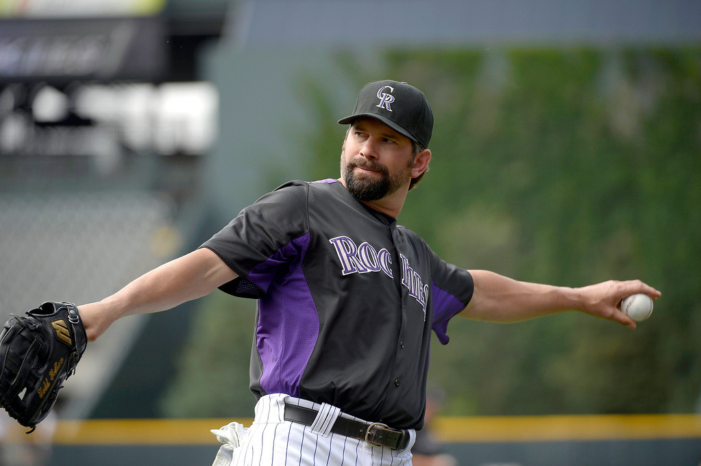 . Colorado Rockies Todd Helton loosens up during an open workout session for the fans July 18, 2013 at Coors Field. (Photo By John Leyba/The Denver Post)