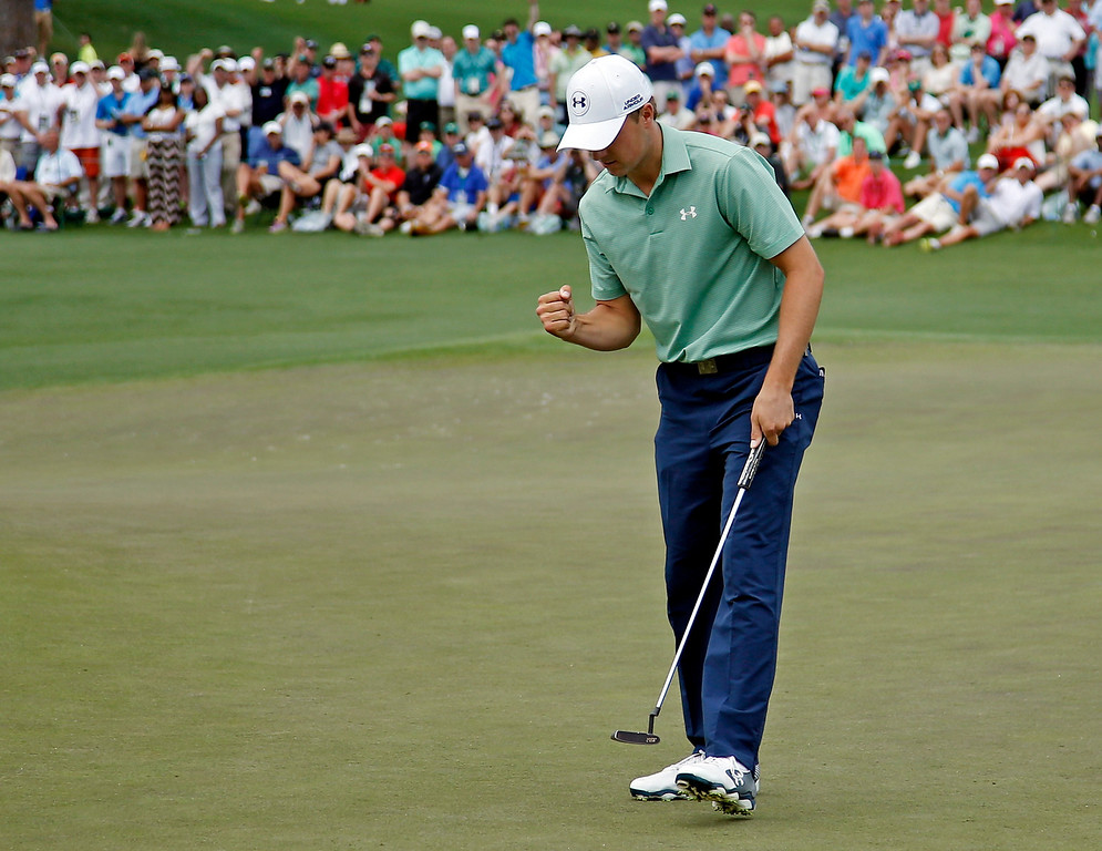 . Jordan Spieth pumps his fist after a birdie putt on the second hole during the fourth round of the Masters golf tournament Sunday, April 13, 2014, in Augusta, Ga. (AP Photo/Matt Slocum)