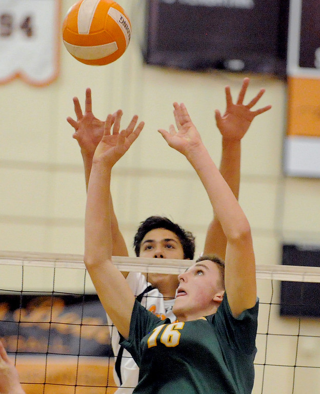 . 05-15-2013-( Daily Breeze Staff Photo by Sean Hiller) Huntington Beach swept Mira Costa in Wednesday\'s  boys volleyball CIF Southern Section Division I semifinal at Huntington Beach High School. Costa\'s Grant Chalmers (16), front, battles HB\'s Brenden Sander (15) at the net.