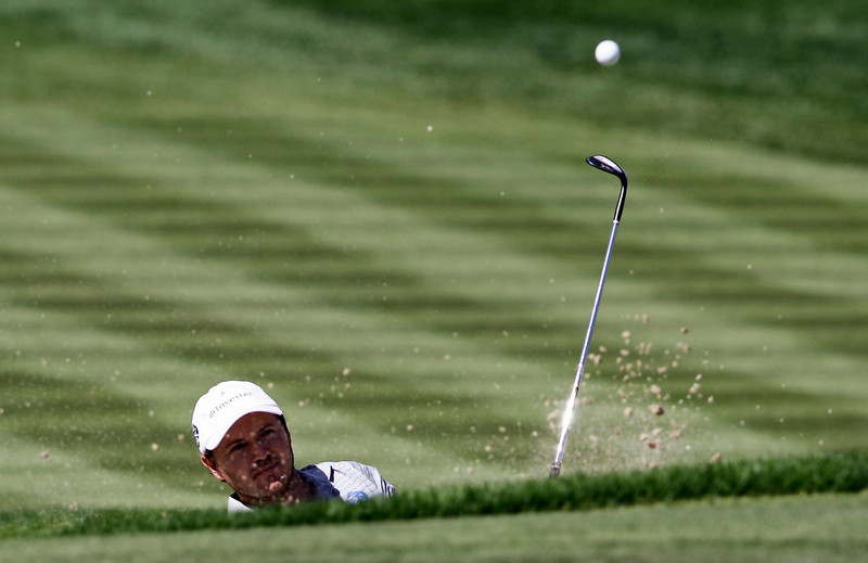 . Richard Sterne from South Africa plays a ball on the 3rd hole during final round of the Dubai Desert Classic Golf tournament in Dubai, United Arab Emirates, Sunday, Feb. 3, 2013. (AP Photo/Kamran Jebreili)