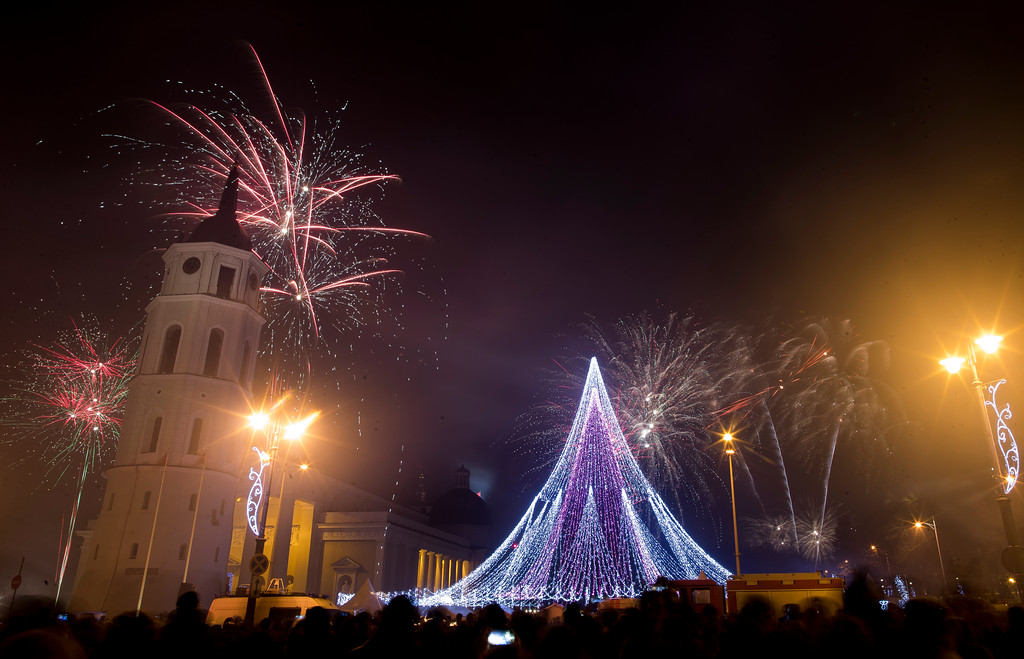 . Fireworks light the sky above the Cathedral Square in Vilnius, Lithuania, shortly after midnight during the New Year\'s celebrations Monday, Jan. 1, 2018. (AP Photo/Mindaugas Kulbis)
