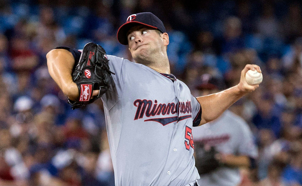 . Twins starter Scott Diamond works against the Blue Jays during the first inning. (AP Photo/The Canadian Press, Chris Young)