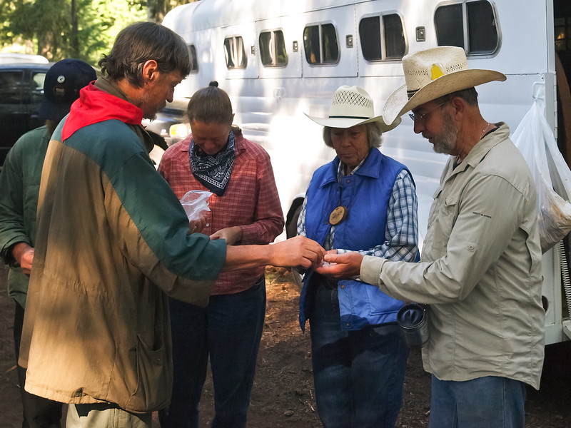 Pinning of the Teamsters (Wagon Drivers) & Swampers (assistants to teamsters) with commemorative pins of the Santiam Wagon Road.