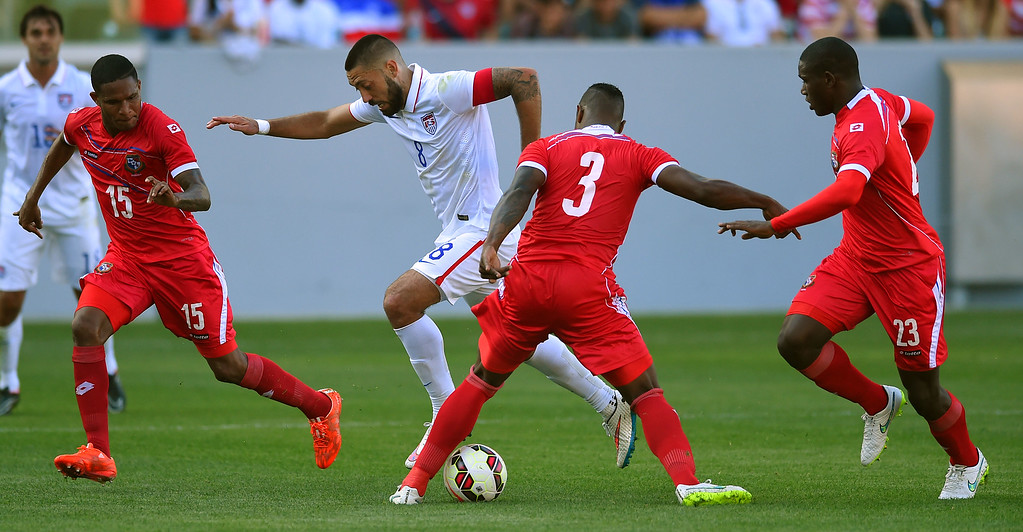 . USA�s Clint Dempsey tries to maneuver the ball through a group of Panama defenders at the StubHub Center in Carson, CA on Sunday, February 8, 2015. US men\'s national team beat Panama 2-0 in an international friendly soccer match. 2nd half. (Photo by Scott Varley, Daily Breeze)