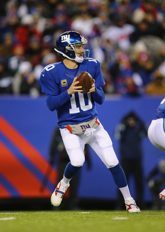 . Eli Manning #10 of the New York Giants drops back to pass against the Dallas Cowboys during their game at MetLife Stadium on November 24, 2013 in East Rutherford, New Jersey.  (Photo by Al Bello/Getty Images)