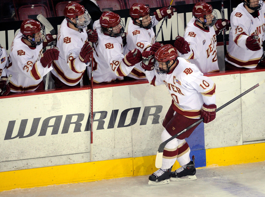 . DENVER, CO. - NOVEMBER 16: Denver defenseman David Makowski accepted congratulations from the bench after his power play goal in the second period. The University of Denver hockey team hosted Western Michigan at Magness Arena Saturday night, November 16, 2013.  Photo By Karl Gehring/The Denver Post