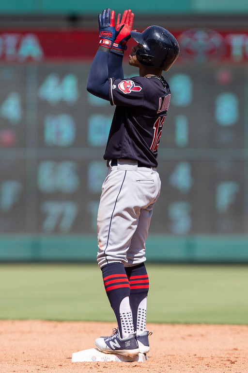 . Cleveland Indians\'Francisco Lindor gestures after hitting a double during the eighth inning of a baseball game against the Texas Rangers, Sunday, July 22, 2018, in Arlington, Texas. (AP Photo/Sam Hodde)