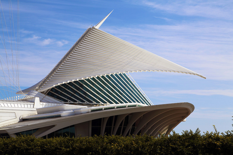 "We reach the Milwaukee Art museum in time to watch its wings unfurl.  The ""wings"" are a huge set of louvres."