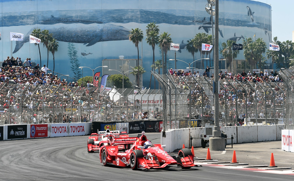 . Toyota Grand Prix of Long Beach winner Scott Dixon leads in front of champagne on 2nd place finisher Helio Castroneves, during the 41st Annual Toyota Grand Prix of Long Beach.  Long Beach  Calif., Sunday,  April,19, 2015.     (Photo by Stephen Carr / Daily Breeze)