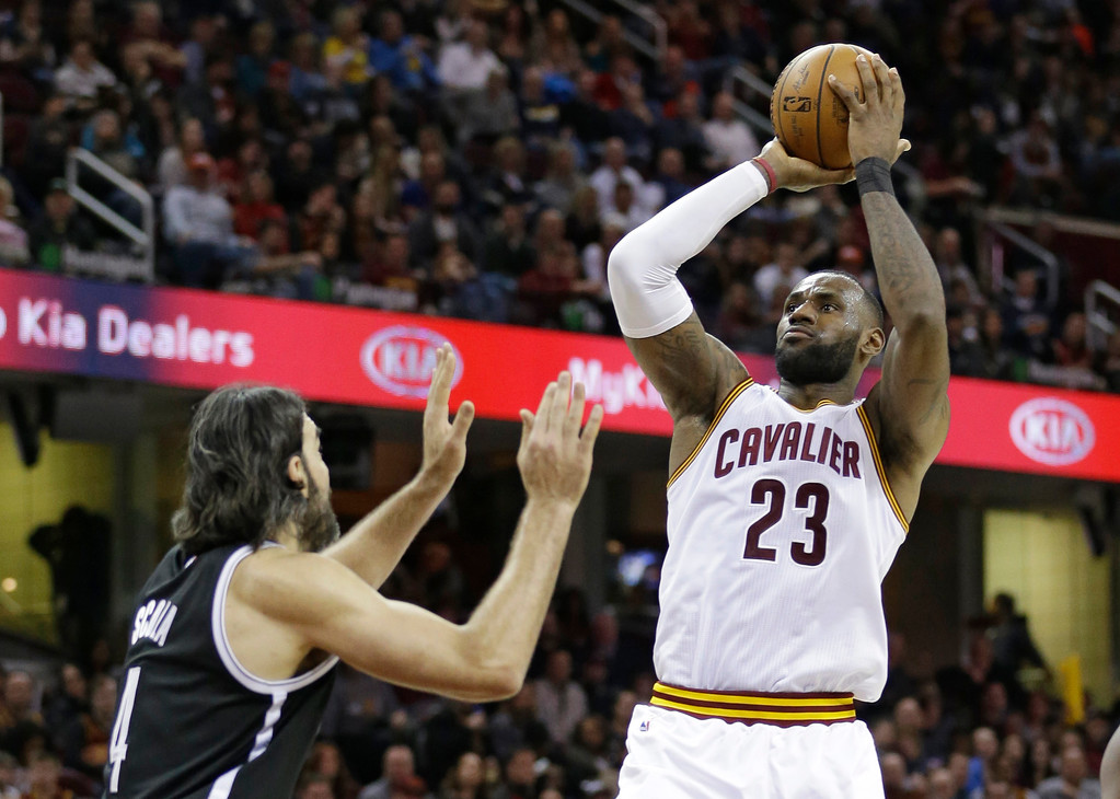 . Cleveland Cavaliers\' LeBron James (23) shoots over Brooklyn Nets\' Luis Scola, (4), from Argentina, in the second half of an NBA basketball game, Friday, Jan. 27, 2017, in Cleveland. (AP Photo/Tony Dejak)