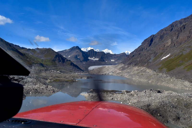 Landing on a glacial pond