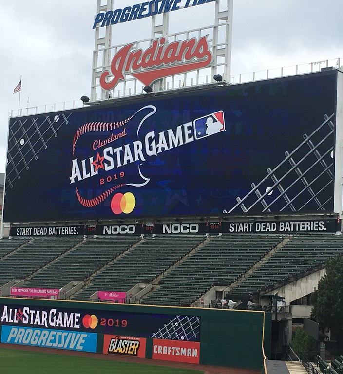. Progressive Field video board and outfield wall displaying 2019 All-Star Game logo. (David S. Glasier - The News-Herald)