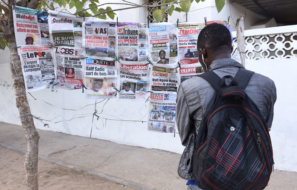 . A man looks, on January 8, 2015 in Dakar, at covers of Senegal\'s newspapers, following an attack on January 7 against French satirical weekly newspaper Charlie Hebdo which left 12 people dead. A stunned and outraged France began a national day of mourning on January 8, as security forces desperately hunted two brothers suspected of gunning down 12 people in an Islamist assault on a satirical weekly, the country\'s bloodiest attack in half a century. AFP PHOTO / SEYLLOU DIALLO/AFP/Getty Images