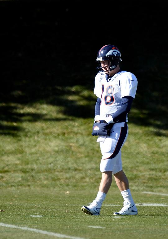 . Denver Broncos quarterback Peyton Manning (18) keeps his hands warm during practice November 6, 2013 at Dove Valley. (Photo by John Leyba/The Denver Post)