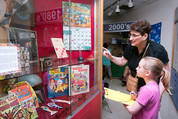08/23/18 Wesley Bunnell | Staff The New Britain Youth Museum held a back to school party featuring activities, prizes and New Britain Bees mascot Sting on Thursday afternoon. Emily Bernard participates in the scavenger hunt along with a little help from grandmother Janice Bernard.