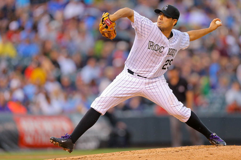 . DENVER, CO - JULY 11: Starting pitcher Jorge De La Rosa #29 of the Colorado Rockies delivers to home plate during the third inning against the Minnesota Twins at Coors Field on July 11, 2014 in Denver, Colorado. (Photo by Justin Edmonds/Getty Images)
