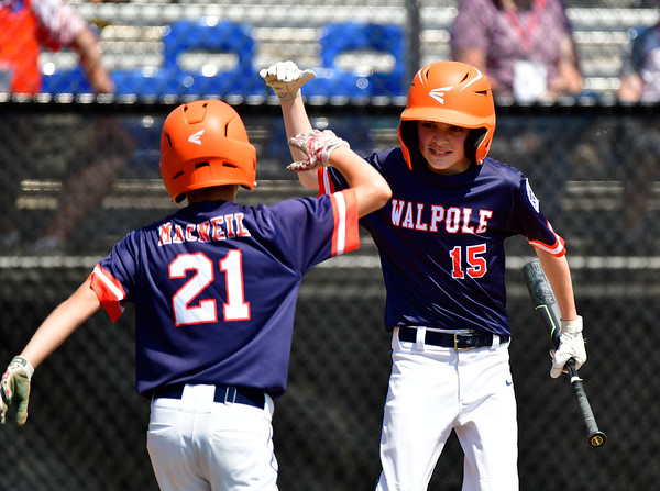 8/4/2019 Mike Orazzi | Staff Massachusetts's Quinn MacNeil (21) and Jackson Marshall (15) celebrate during a win in the opening round game of the New England Regional Little League Baseball Tournament in Bristol on Sunday.