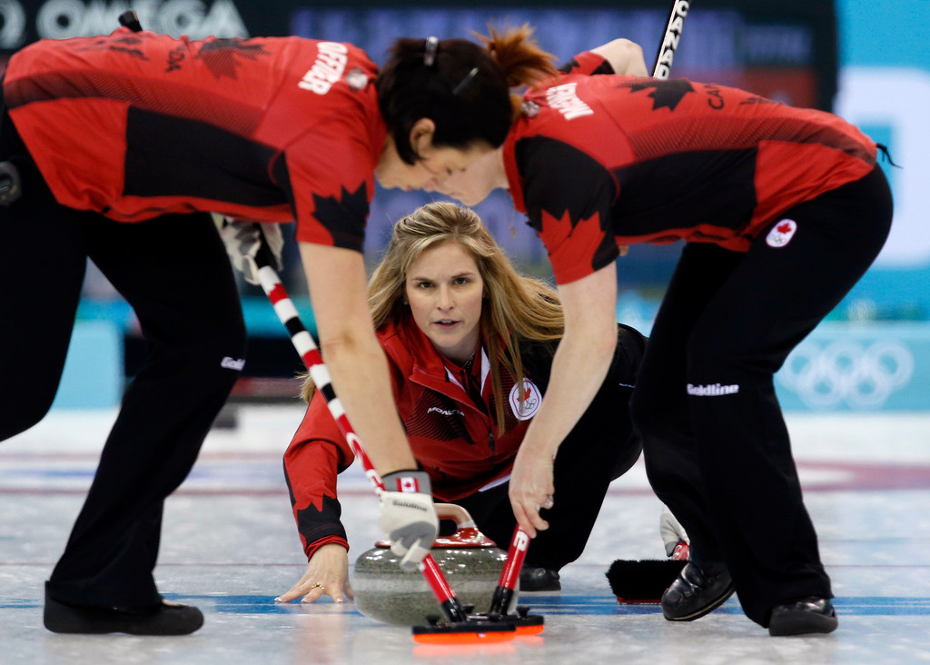 . Canada\'s skip Jennifer Jones delivers the stone during women\'s curling competition against South Korea at the 2014 Winter Olympics, Monday, Feb. 17, 2014, in Sochi, Russia. (AP Photo/Robert F. Bukaty)