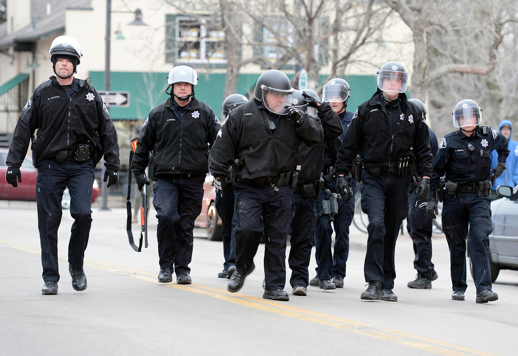 . Boulder Sheriff\'s deputies dressed in riot gear enter the scene during a disturbance at the The Fox Theater on Monday, March 11, in Boulder. Boulder Police responded with riot gear to keep the fans of the band Tyler the Creator under control.  Jeremy Papasso/Boulder Daily Camera