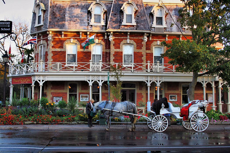 Town of Niagara on the Lake, Canada, near Niagara Falls,  October 2007. This was taken just before sunset in heavy shadows, and HDR imaging was used here to bring out the shadows under the porch and in the foliage.