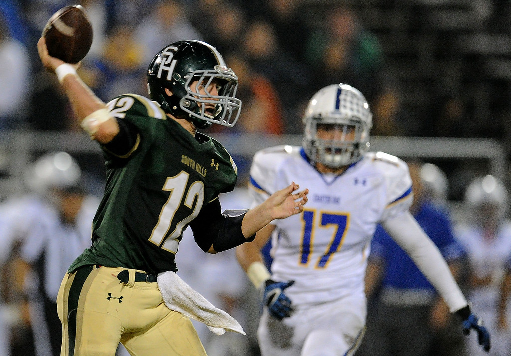 . South Hills quarterback Adam Goss (12) passes as Charter Oak\'s Jason Ortiz (17) looks on in the second half of a prep football game at Covina DIstrict Field in Covina, Calif., on Thursday, Oct. 24, 2013.    (Keith Birmingham Pasadena Star-News)
