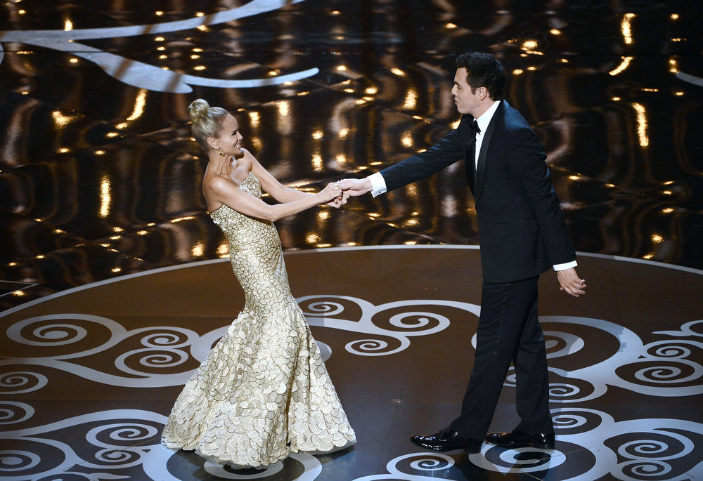 Description of . Actress Kristin Chenoweth and host Seth MacFarlane perform onstage during the Oscars held at the Dolby Theatre on February 24, 2013 in Hollywood, California.  (Photo by Kevin Winter/Getty Images)