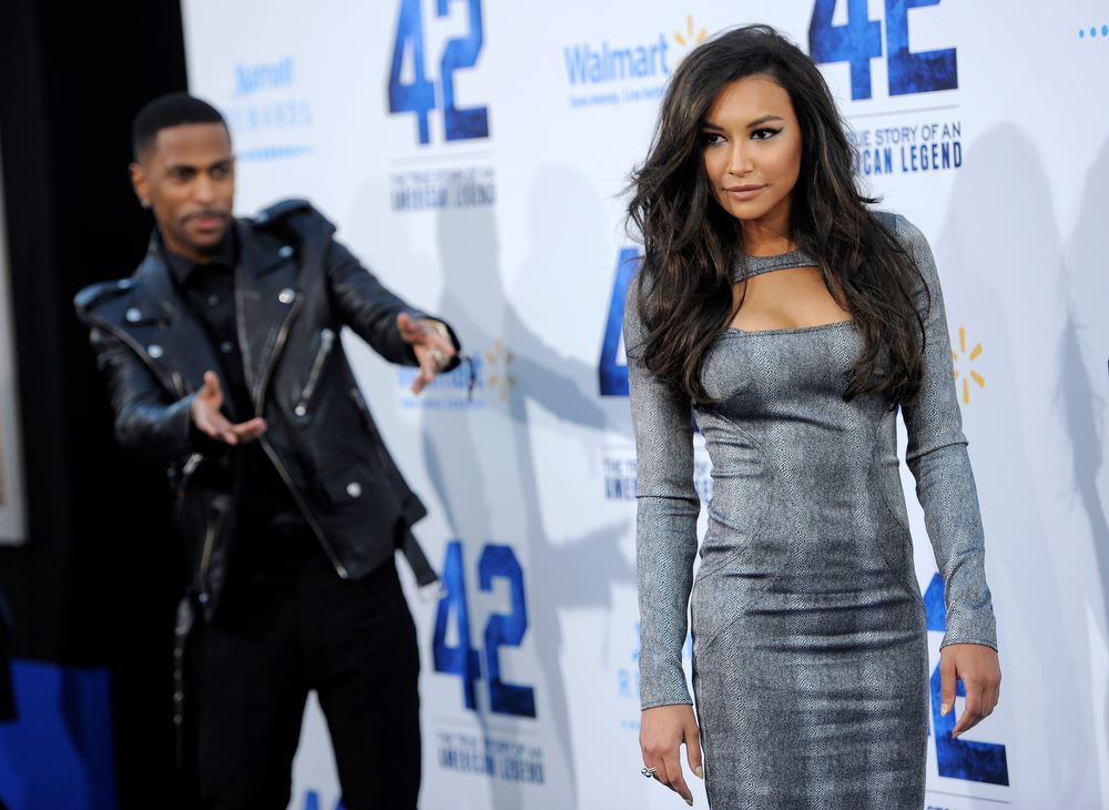 ". Actress Naya Rivera poses as her boyfriend, rapper Big Sean, looks on at the Los Angeles premiere of ""42\"" at the TCL Chinese Theater on Tuesday, April 9, 2013 in Los Angeles. (Photo by Chris Pizzello/Invision/AP)"