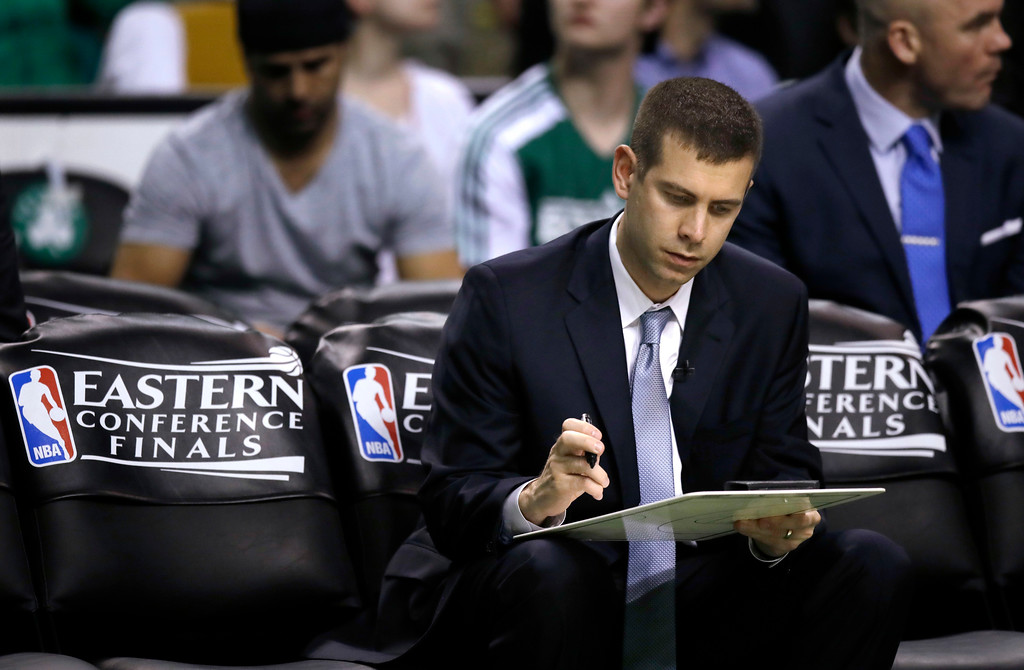 . Boston Celtics coach Brad Stevens studies his clipboard before the third quarter of Game 1 of the NBA basketball Eastern Conference finals against the Cleveland Cavaliers, Wednesday, May 17, 2017, in Boston. (AP Photo/Charles Krupa)