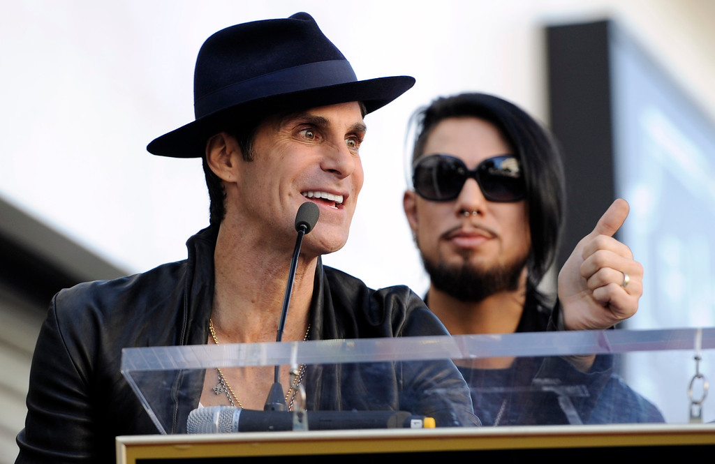 . Perry Farrell, left, lead singer of Jane\'s Addiction, addresses the crowd as guitarist Dave Navarro looks on during a ceremony to award the band a star on the Hollywood Walk of Fame on Wednesday, Oct. 30, 2013 in Los Angeles. (Photo by Chris Pizzello/Invision/AP)
