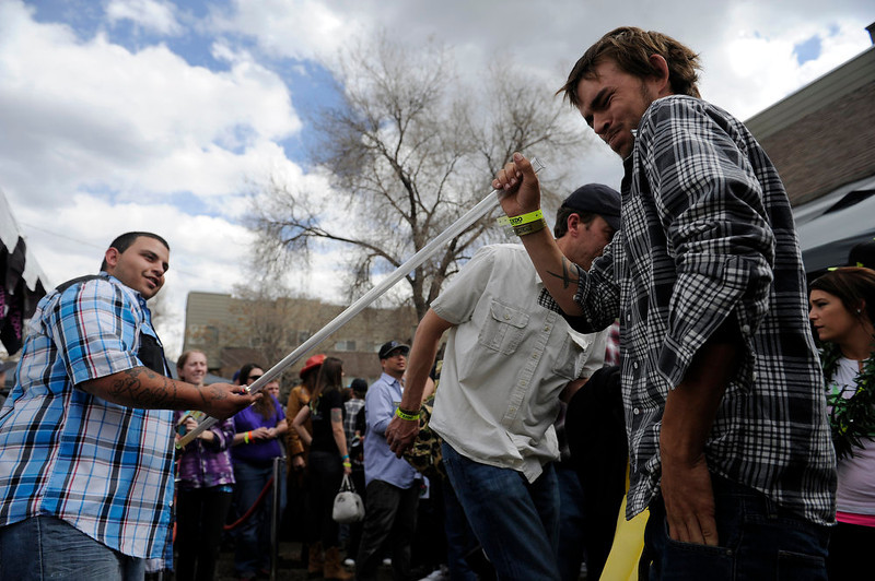 . Greg Longley of Tampa, Fla, reacts after taking a hit off a la fumo pipe being held by Daniel Robles during the High Times US Cannabis Cup at the Exdo Center in Denver on Saturday, April 20, 2013. Seth A. McConnell, The Denver Post